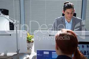 Executive working together at desk