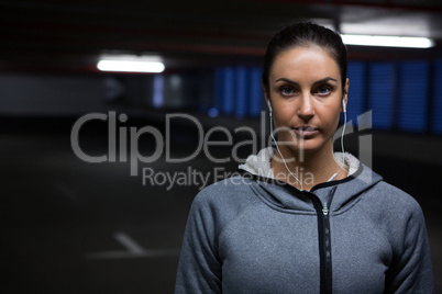 Fit woman standing in underground parking area