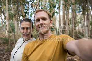 Hiker couple taking selfie in the forest