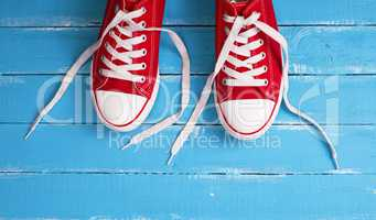 pair of red  sneakers with white laces