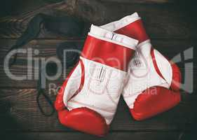 a pair of leather red boxing gloves
