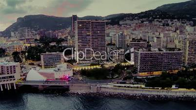 Monaco city town Monte Carlo Drone flight port yachts sea flats evening