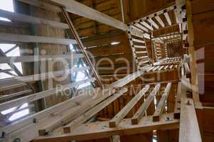 stairwell view from below, the wooden stairs to the observation