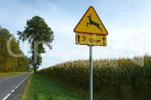 "sign ""beware of animals crossing traffic"" road warning"