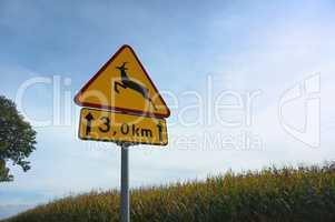 "road warning sign ""beware of animals crossing traffic"""
