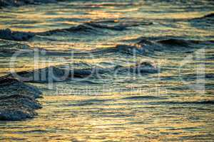 surf of the Baltic sea with morning sun