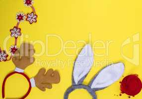 carnival headdresses on a yellow background