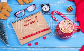 paper notebook with the inscription Happy New Year