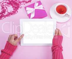electronic tablet with an empty white screen in female hands
