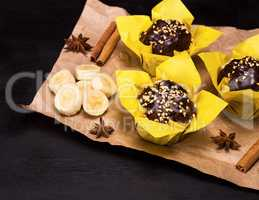 banana muffins wrapped in yellow paper