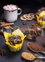 banana chocolate muffins on a black surface