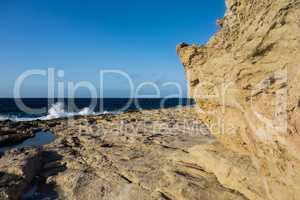 Rocky coastline and blue sky in Malta.