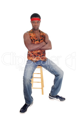 Handsome African man sitting in a vest