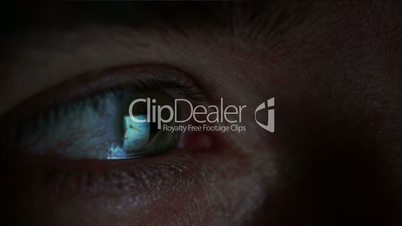 Reflection in the eye screen with stock market trading data.