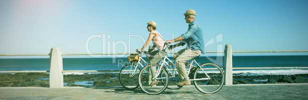 Full length of couple riding bicycles