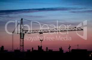 building crane sunset