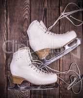 female white leather skates for figure skating