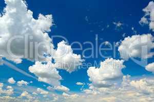 Heavenly landscape. Cumulus clouds in blue sky.