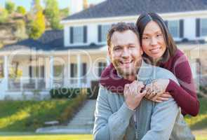 Mixed Race Caucasian and Chinese Couple In Front Yard of Beautif