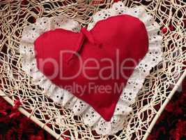 Red heart shape on shredded paper