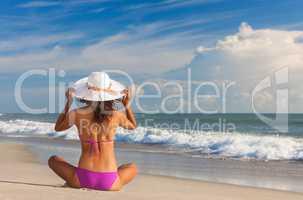 Rear View Beautiful Woman At Beach in Hat and Bikini