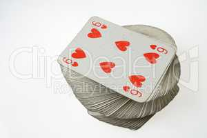 Six of Hearts at the top of playing card deck