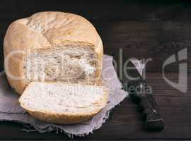 round yeast bread and a kitchen knife
