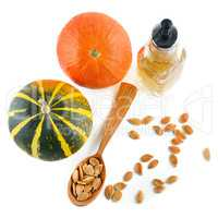 Oil, seeds and pumpkin fruits isolated on white background.