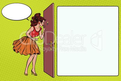 woman peeking through the peephole
