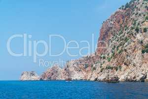 Cruise boats with tourists on Board, sailing along the magnificent scenic route along the Mediterranean coast