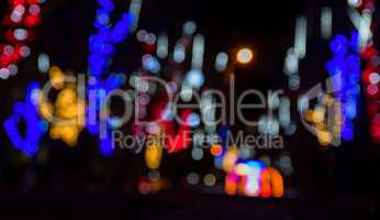 Blurred background of the street at night with luminous electric