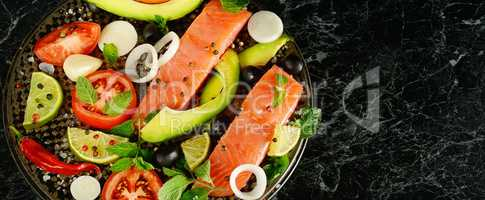 Fillet of red fish and spices on a black background. Free space