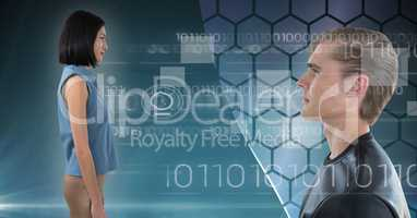 Man and woman looking forward in digital world