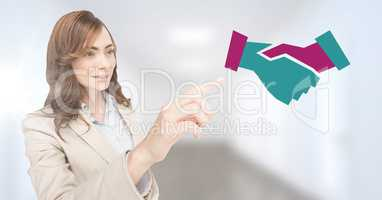 Businesswoman pointing at handshake icon