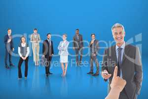 Hand choosing a business man on blue background with business people