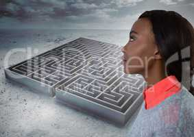 Young woman looking past maze
