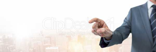 Hand pointing with businessman  over city