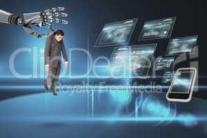 Robot hand choosing a business man on dark background