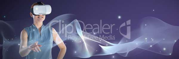 Composite image of smiling businesswoman with hand on hip gesturing while wearing virtual reality gl