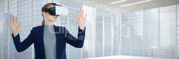 Composite image of young businesswoman gesturing while wearing vr glasses