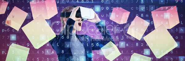 Composite image of surprised young businesswoman wearing vr glasses