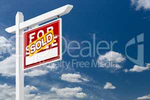 Right Facing Sold For Sale Real Estate Sign Over Blue Sky and Cl