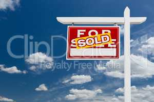 Left Facing Sold For Sale Real Estate Sign Over Blue Sky and Clo