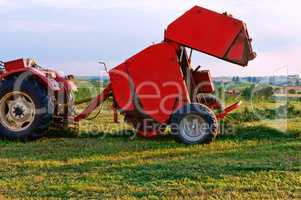 agricultural machine for gathering hay and straw, stacker differently, harvester