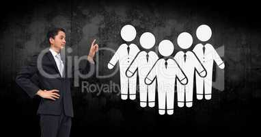 Businessman pointing at people group icons