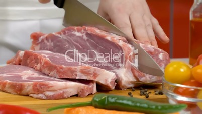 Slicing fresh raw meat for cooking