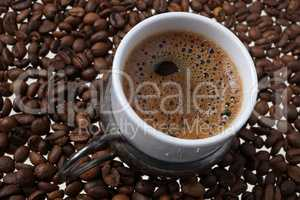 Close up of traditional Turkish coffee - Coffee beans background