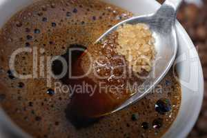 Close up of adding brown sugar in traditional Turkish coffee