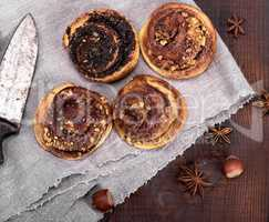 round buns with cinnamon and poppies on a gray textile napkin