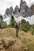 Man hiking in the nature park Geisler-Puez in South Tyrol